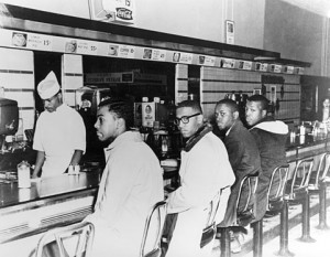 February 2, 1960, Joseph A. McNeil, Franklin E. McCain, William Smith, and Clarence Henderson at the Woolworth lunch counter in Greensboro, North Carolina. Photo courtesy of Greensboro News and Record