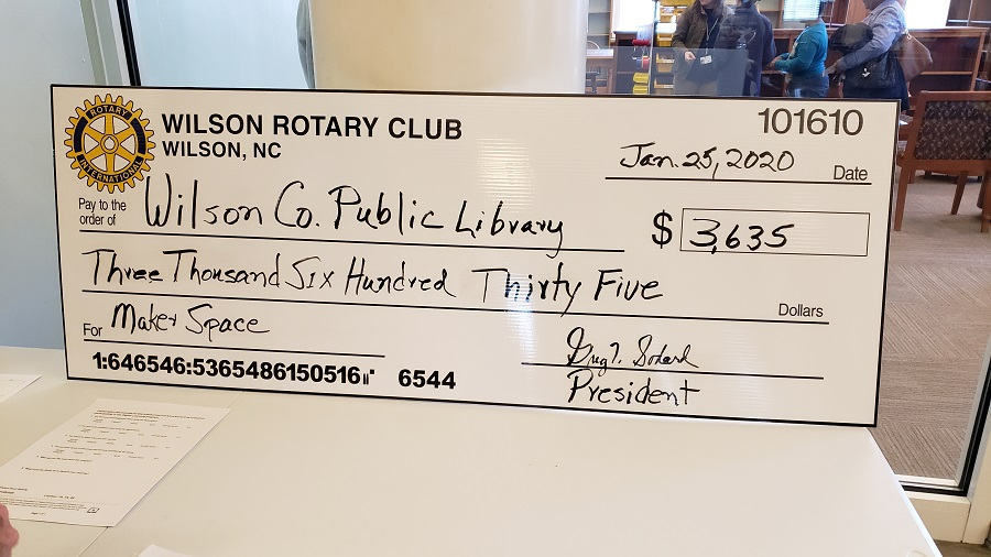 "Wilson Rotary Club ""big check"" representing their donation to the library. Source: Amanda Gardner, Wilson County Public Library"