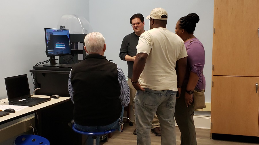 Scott Houston demonstrates the 3D printer to a group of adults. Source: Amanda Gardner, Wilson County Public Library