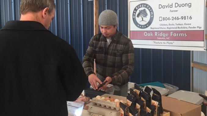 David Duong of Oak Ridge Farms during a Winter farm market day. Photo: Kay Whatley