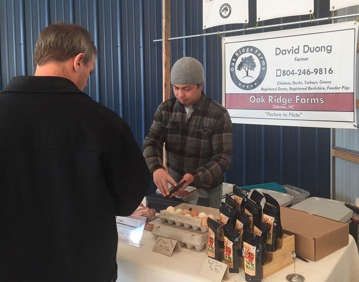 David Duong of Oak Ridge Farms during a December farm market. Photo: Kay Whatley