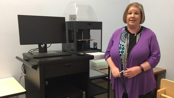 Amanda Gardner of WCPL with the Makerspace 3D printer. Photo: Kay Whatley