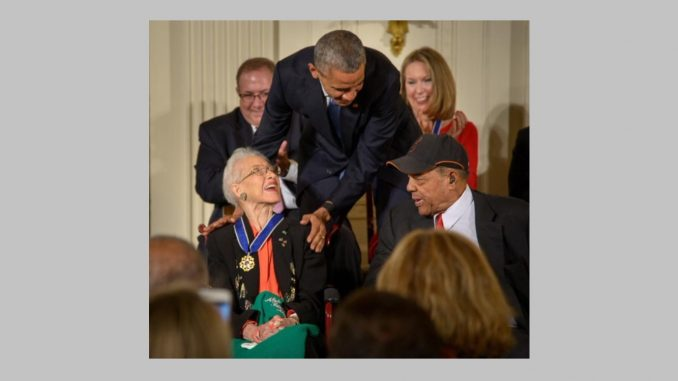 President Barack Obama presents former NASA mathematician Katherine Johnson with the Presidential Medal of Freedom, as professional baseball player Willie Mays, right, looks on, November 24, 2015, during a ceremony at the White House. Photo: NASA/Bill Ingalls