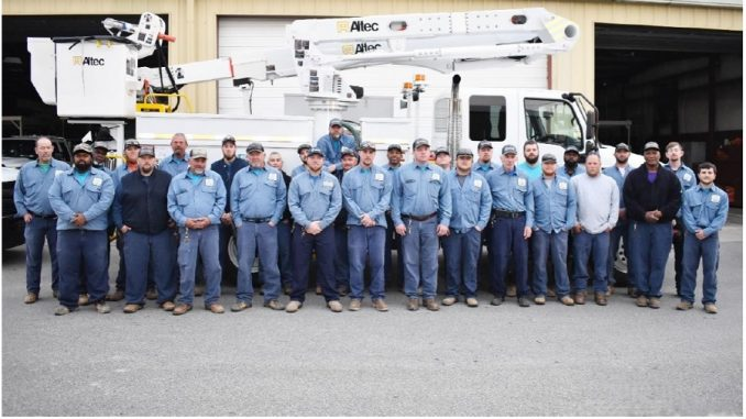 The above photo of lineworkers in the Energy Resources department was taken at a date prior to COVID-19 related guidelines that require social distancing. Source: Amy Blanton, City of Rocky Mount