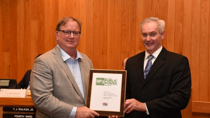 Mayor Sandy Roberson and Director of Energy Resources Chris Beschler accept the RP3 award. Source: Amy Blanton, City of Rocky Mount, NC
