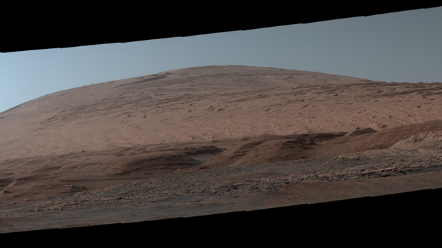 The Mast Camera, or Mastcam, on NASA's Curiosity Mars rover used its telephoto lens to capture Mount Sharp in the morning illumination on Oct. 13, 2019, the 2,555th Martian day, or sol, of the mission. The panorama is composed of 44 individual images stitched together. Credit: NASA/JPL-Caltech/MSSS