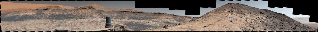 This wide panorama was taken by NASA's Curiosity Mars rover on Dec. 19, 2019, the 2,620th Martian day, or sol, of the mission. On the righthand foreground is Western Butte; the ridge with a crusty cap in the background is the Greenheugh pediment, which Curiosity ascended in March of 2020. Credit: NASA/JPL-Caltech/MSSS