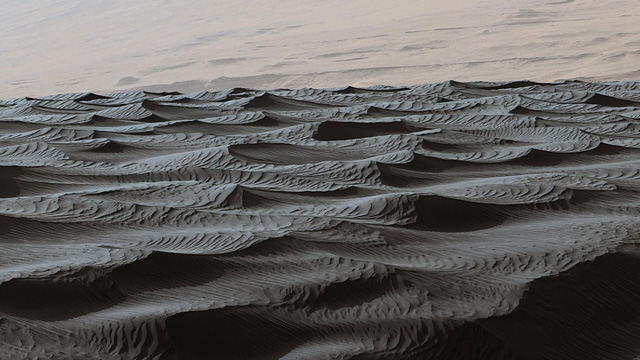 Two sizes of wind-sculpted ripples are evident in this view of the top surface of a Martian sand dune. Sand dunes and the smaller type of ripples also exist on Earth. The larger ripples -- roughly 10 feet (3 meters) apart -- are a type not seen on Earth nor previously recognized as a distinct type on Mars. Credit: NASA/JPL-Caltech/MSSS