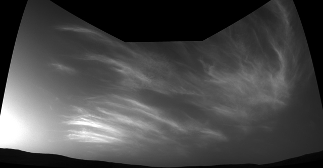 NASA's Curiosity Mars rover imaged these drifting clouds on May 17, 2019, the 2,410th Martian day, or sol, of the mission, using its black-and-white Navigation Cameras (Navcams). Credit: NASA/JPL-Caltech