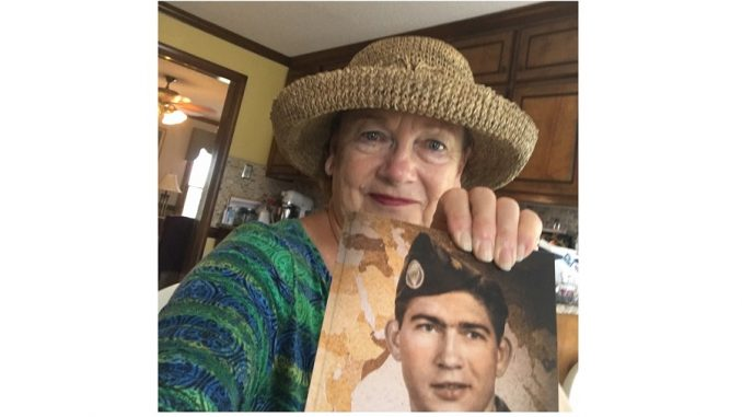 Mary Susan Heath with her book, Legs Astride the World. Source: Cindy Brookshire, Johnston County Writers Group