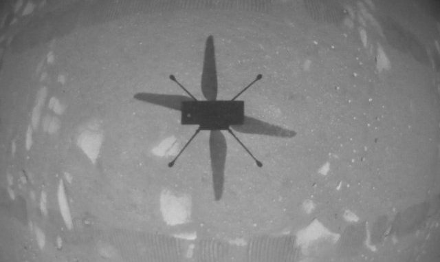 NASA's Ingenuity Mars Helicopter took this shot, capturing its own shadow, while hovering over the Martian surface on April 19, 2021. Credit: NASA/JPL-Caltech