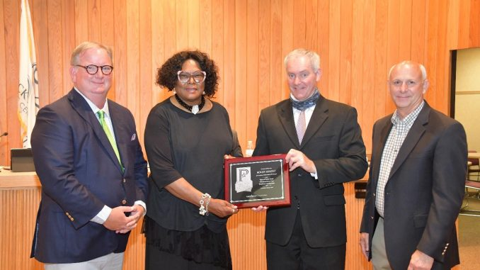 Pictured (l-r): Mayor Roberson; City Manager Rochelle Small-Toney; Chris Beschler, director of Energy Resources; Roy Jones, chief executive officer of ElectriCities of North Carolina, Inc.